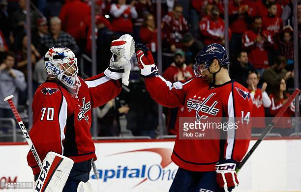 Goalie Braden Holtby and Justin Williams of the Washington Capitals celebrate after the Capitals defeated the Colorado Avalanche 73 at Verizon Center...