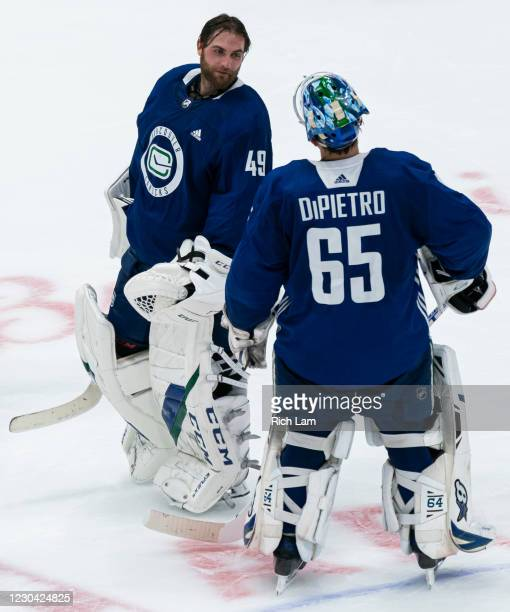 Goalie Braden Holtby of the Vancouver Canucks and Michael Dipietro talk after their session on the first day of the Vancouver Canucks NHL Training...