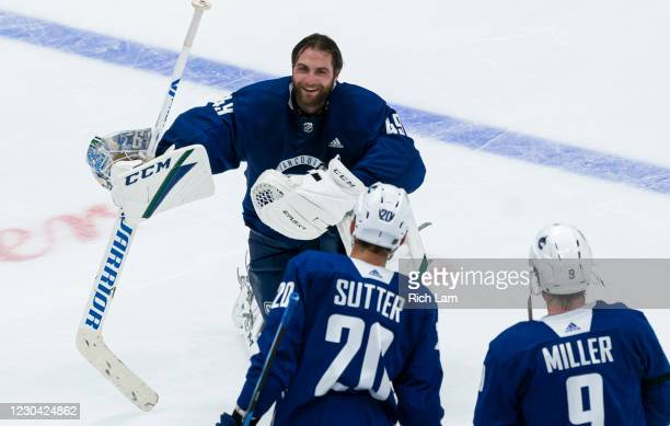 Goalie Braden Holtby of the Vancouver Canucks shares a laugh with Jake Kielly and JT Miller after their session on the first day of the Vancouver...