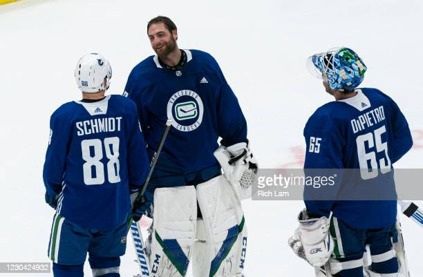 Goalie Braden Holtby of the Vancouver Canucks shares a laugh with Nate Schmidt and Michael Dipietro after their session on the first day of the...