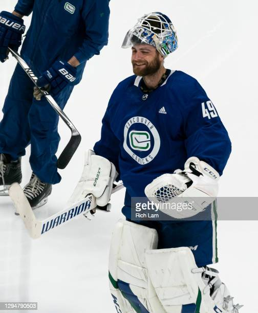 Goalie Braden Holtby of the Vancouver Canucks smiles while skating at the beginning of the first session on the first day of the Vancouver Canucks...