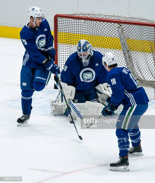 Goalie Braden Holtby of the Vancouver Canucks stops a shot while Brandon Sutter and Jake Virtanen looks for a rebound on the first day of the...