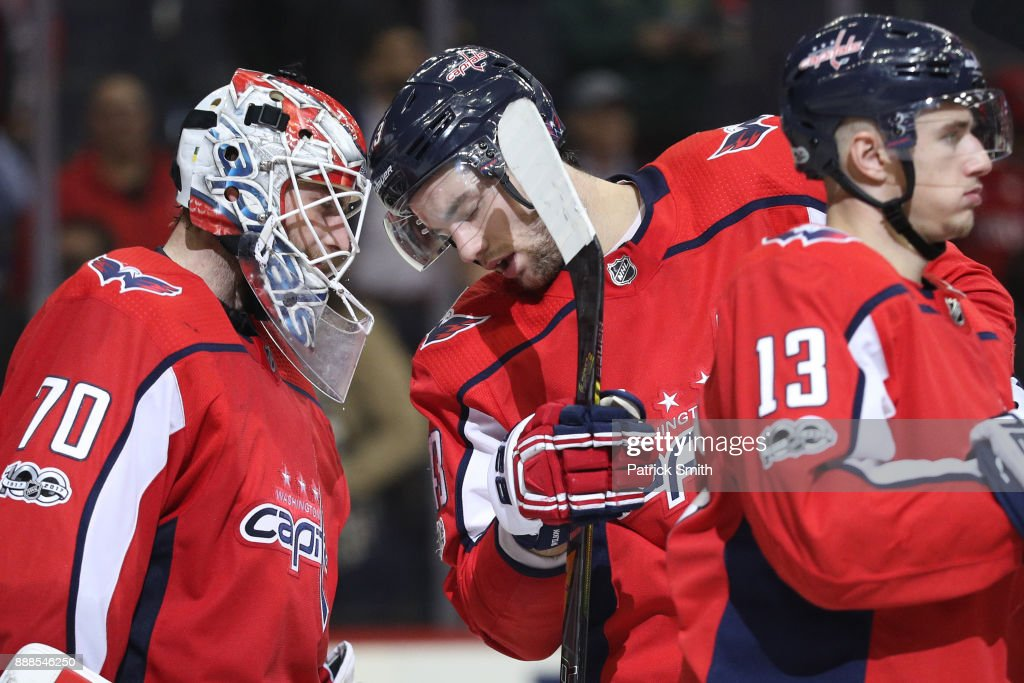 Goalie Braden Holtby #70 of the Washington Capitals and Tom Wilson #43 celebrate after defeating the Chicago Blackhawks at Capital One Arena on December 06, 2017 in Washington, DC.