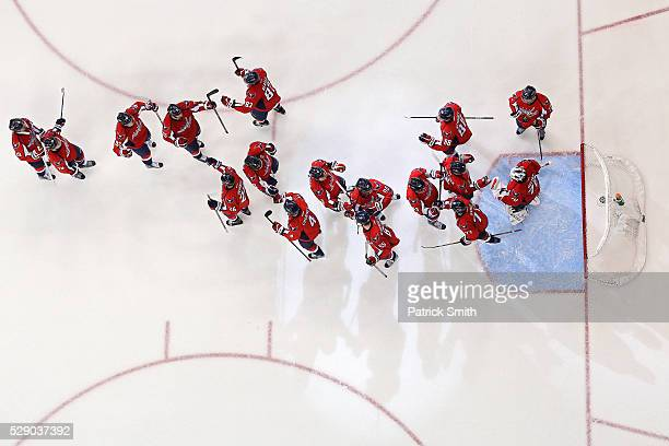 Goalie Braden Holtby of the Washington Capitals celebrates with teammates after defeating the Pittsburgh Penguins in Game Five of the Eastern...