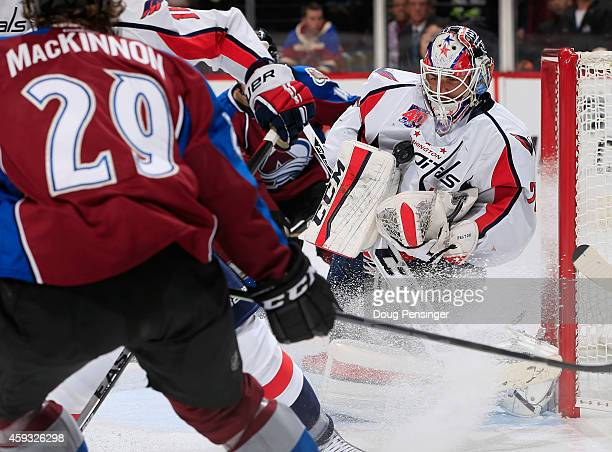 Goalie Braden Holtby of the Washington Capitals collects the puck as he makes a save against the Colorado Avalanche at Pepsi Center on November 20...