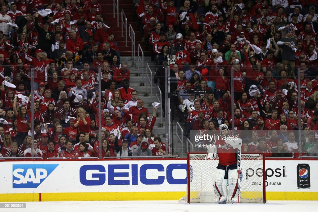 Goalie Braden Holtby #70 of the Washington Capitals looks on after giving up a third period goal against the Pittsburgh Penguins in Game Seven of the Eastern Conference Second Round during the 2017 NHL Stanley Cup Playoffs at Verizon Center on May 10, 2017 in Washington, DC.