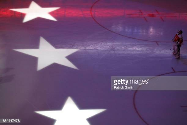 Goalie Braden Holtby of the Washington Capitals looks on during the National Anthem before playing the Detroit Red Wings at Verizon Center on...
