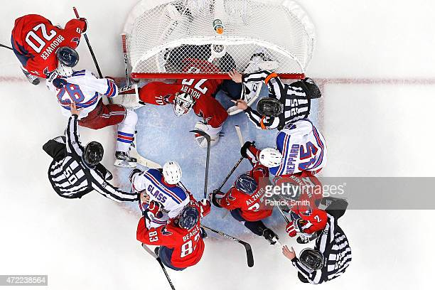 Goalie Braden Holtby of the Washington Capitals makes a save against the New York Rangers as players scuffle in the during the second period in Game...