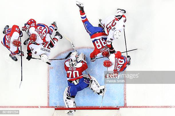Goalie Braden Holtby of the Washington Capitals makes a save in the second period on Mark Borowiecki of the Ottawa Senators at Verizon Center on...