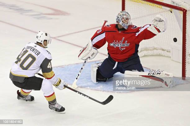 Goalie Braden Holtby of the Washington Capitals makes a save on a shot by Ryan Carpenter of the Vegas Golden Knights during the first period at...