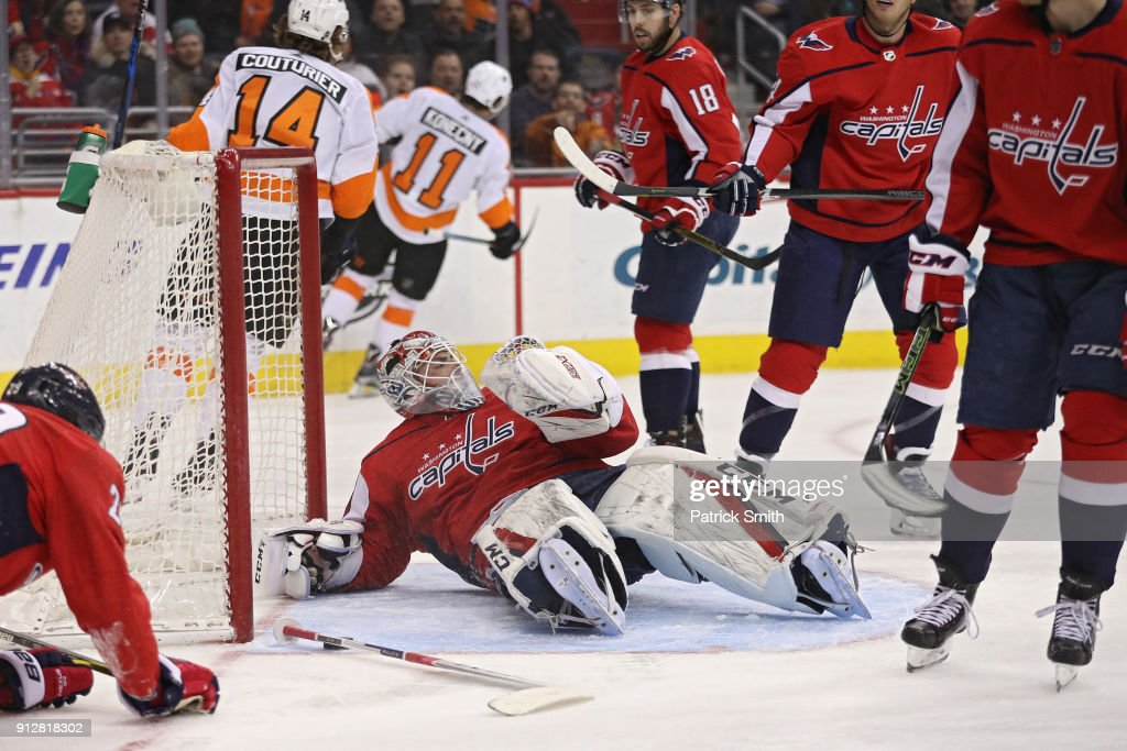 Goalie Braden Holtby #70 of the Washington Capitals reacts after allowing a goal to Travis Konecny #11 of the Philadelphia Flyers during the first period at Capital One Arena on December 31, 2018 in Washington, DC.