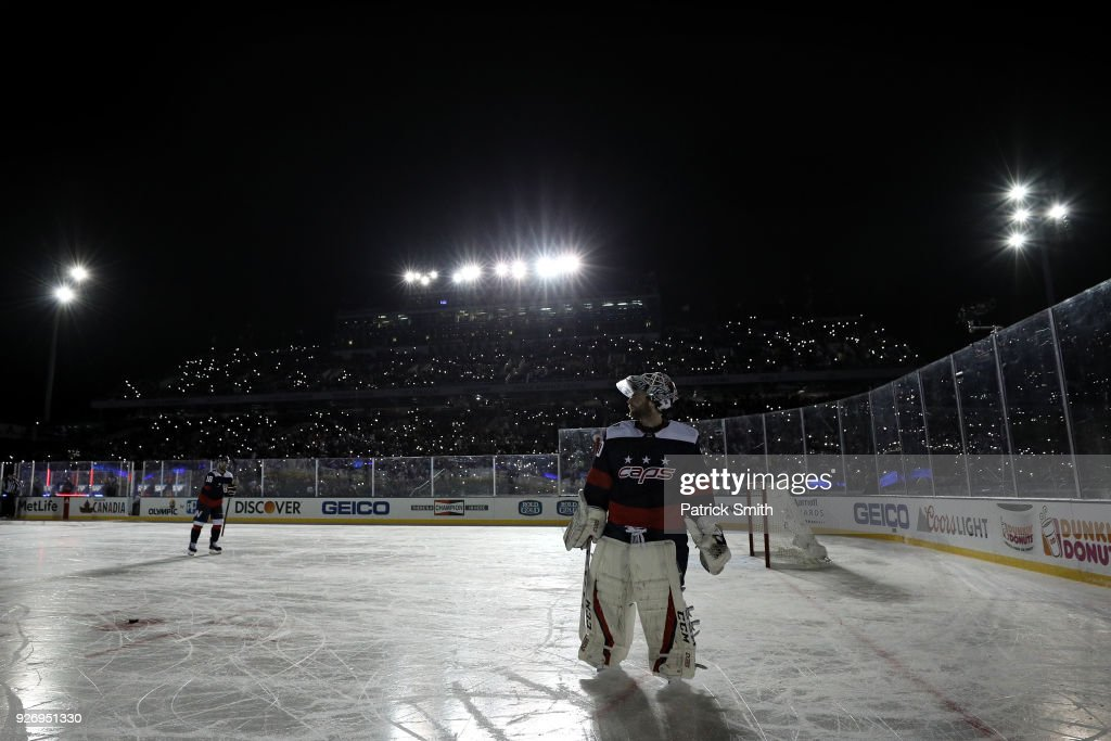 Goalie Braden Holtby #70 of the Washington Capitals skates during a power outage delay against the Toronto Maple Leafs during the third period in the Coors Light NHL Stadium Series at Navy-Marine Corps Memorial Stadium on March 3, 2018 in Annapolis, Maryland.
