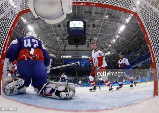 Goalie Branislav Konrad of Slovakia Russian athlete Vadim Shipachyov and Tomas Surovy of Slovakia watch the puck during the second period of the...