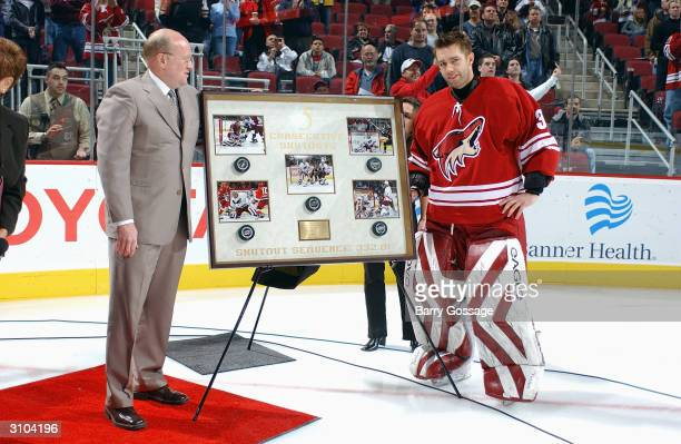 Goalie Brian Boucher of the Phoenix Coyotes is given an award honoring his five consecutive shut-outs, prior to the game against the Calgary Flames...
