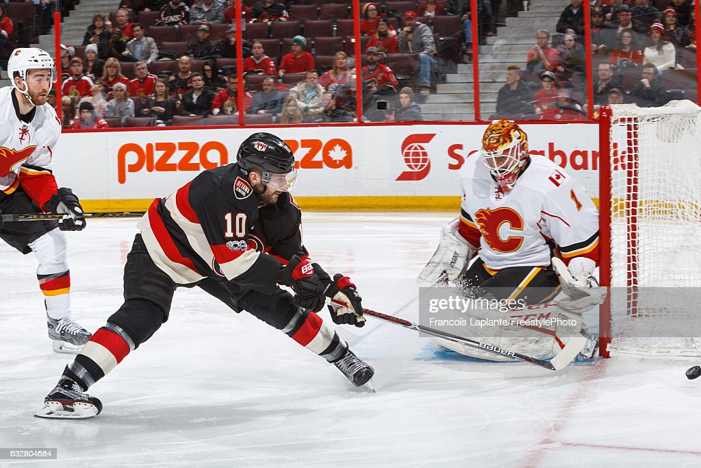Goalie Brian Elliott #1 of the Calgary Flames makes a save against Tom Pyatt #10 of the Ottawa Senators during an NHL game at Canadian Tire Centre on January 26, 2017 in Ottawa, Ontario, Canada.