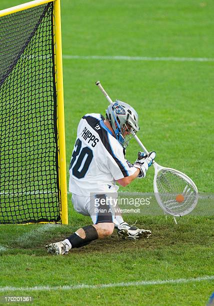 Goalie Brian Phipps of the Ohio Machine makes a save during second quarter action against the Charlotte Hounds at American Legion Memorial Stadium on...