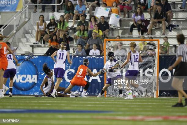 Goalie Brianne LoManto of Northwestern University makes a save against Kailah Kempney of Syracuse University during the Division I Womens Lacrosse...