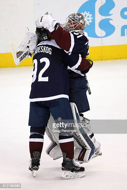 Goalie Calvin Pickard and Gabriel Landeskog of the Colorado Avalanche celebrate their 43 overtime shoot out victory over the San Jose Sharks at Pepsi...