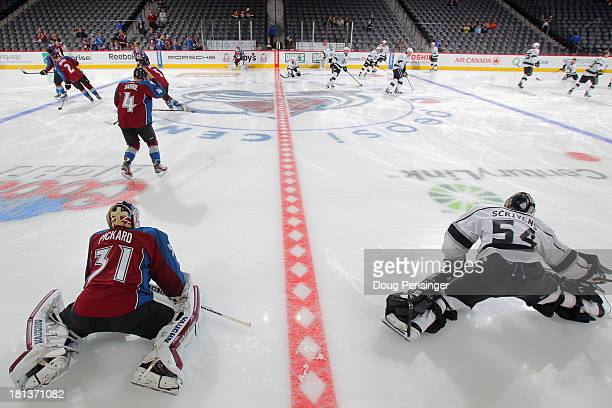 Goalie Calvin Pickard of the Colorado Avalanche and goalie Ben Scrivens of the Los Angeles Kings warm up prior to a preseason game at the Pepsi...