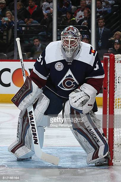 Goalie Calvin Pickard of the Colorado Avalanche defends the goal against the San Jose Sharks at Pepsi Center on February 24 2016 in Denver Colorado...