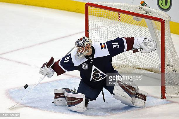 Goalie Calvin Pickard of the Colorado Avalanche deflects the puck to make a save against the San Jose Sharks at Pepsi Center on February 24 2016 in...