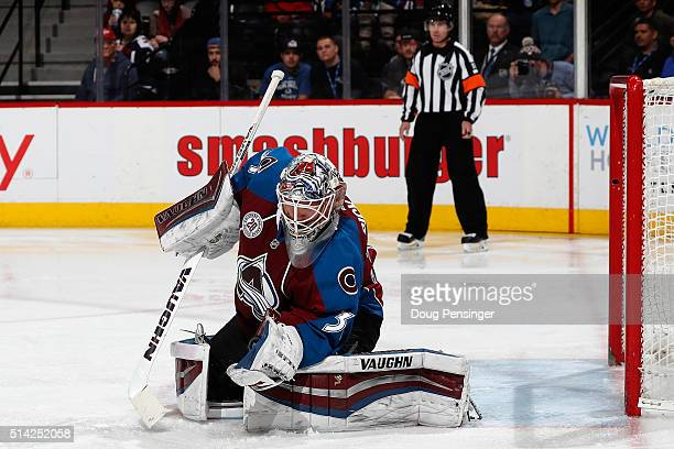 Goalie Calvin Pickard of the Colorado Avalanche makes a glove save against the Nashville Predators at Pepsi Center on March 5 2016 in Denver Colorado...