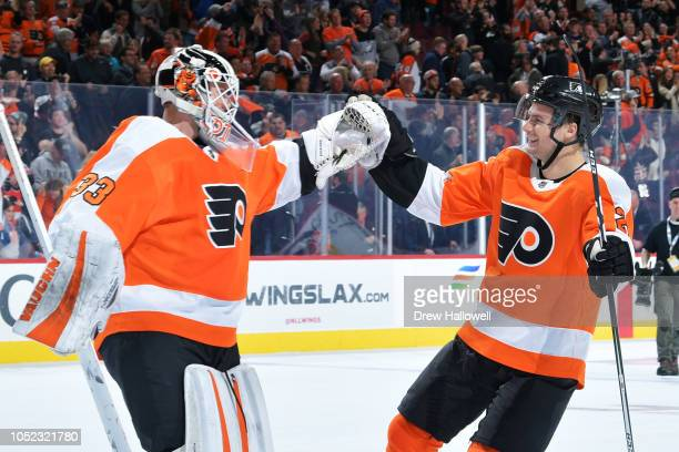 Goalie Calvin Pickard of the Philadelphia Flyers and teammate Scott Laughton of the Philadelphia Flyers celebrate a 65 win over the Florida Panthers...