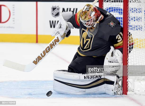 Goalie Calvin Pickard of the Vegas Golden Knights stops the puck against Los Angeles Kings at TMobile Arena on September 26 2017 in Las Vegas Nevada