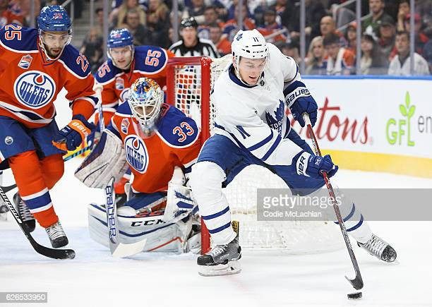 Goalie Cam Talbot of the Edmonton Oilers keeps his eye on the puck as Zach Hyman of the Toronto Maple Leafs looks for a shot on November 29 2016 at...