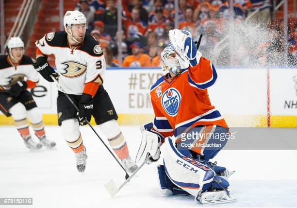 Goalie Cam Talbot of the Edmonton Oilers makes a save against Nick Ritchie of the Anaheim Ducks in Game Four of the Western Conference Second Round...