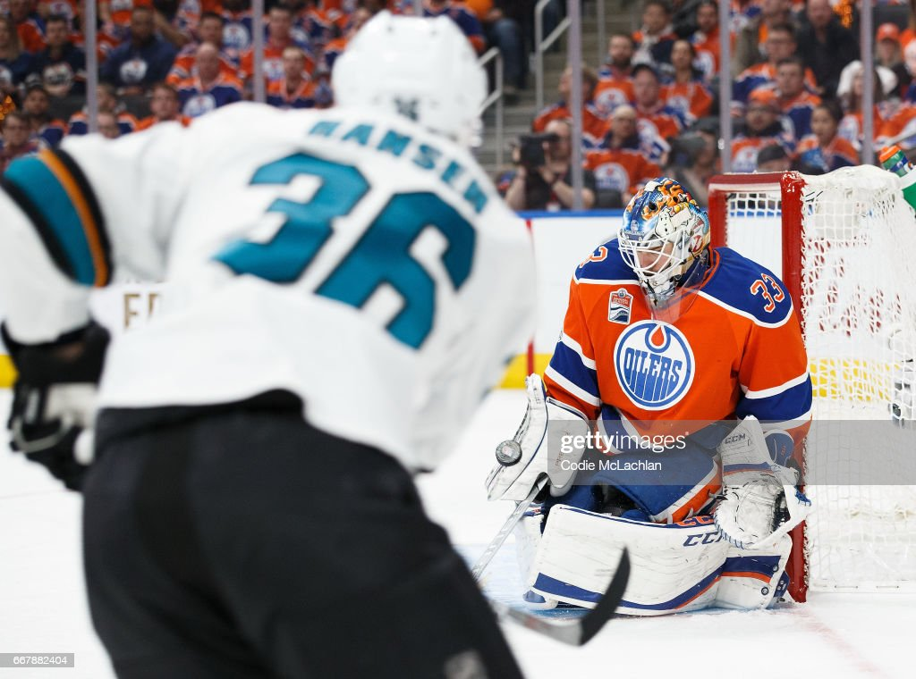 Goalie Cam Talbot #33 of the Edmonton Oilers stops a shot by Jannik Hansen #36 of the San Jose Sharks in Game One of the Western Conference First Round during the 2017 NHL Stanley Cup Playoffs at Rogers Place on April 12, 2017 in Edmonton, Alberta, Canada.
