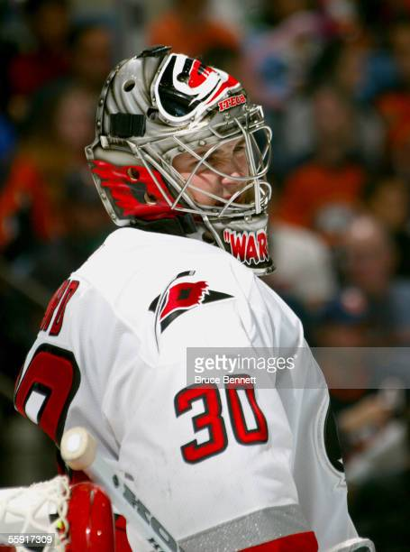 Goalie Cam Ward of the Carolina Hurricanes grimaces during the game against the New York Islanders on October 8, 2005 at the Nassau Coliseum in...