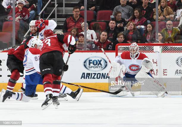 Goalie Carey Price of the Montreal Canadiens looks to make a save on a shot by Oliver EkmanLarsson of the Arizona Coyotes at Gila River Arena on...