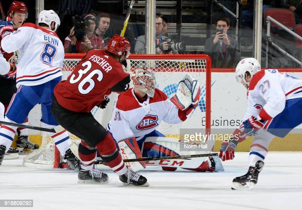 Goalie Carey Price of the Montreal Canadiens makes a glove save on the shot by Christian Fischer of the Arizona Coyotes as Alex Galchenyuk of the...