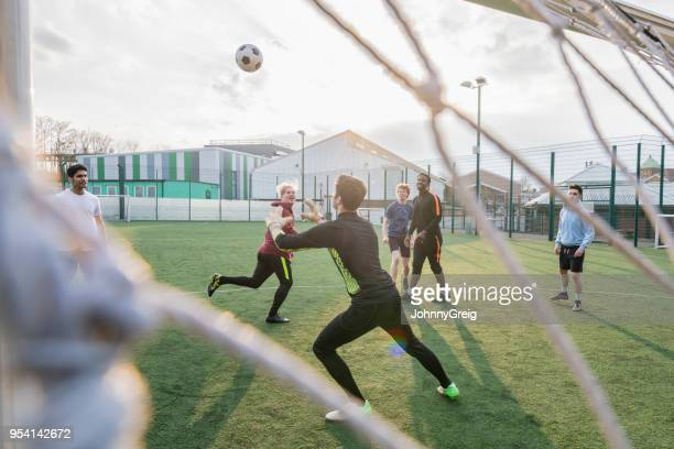 goalie catching ball in game of football - sport di squadra foto e immagini stock