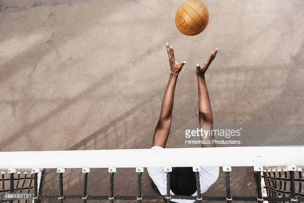 goalie catching soccer ball - defender soccer player stock photos and pictures