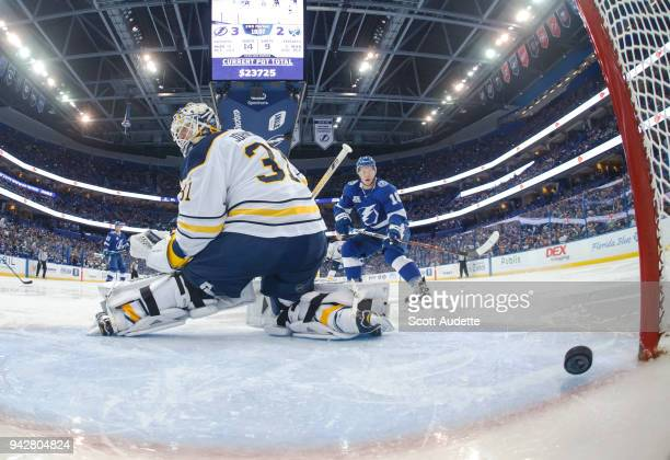 Goalie Chad Johnson of the Buffalo Sabres gives up a goal against Ondrej Palat and the Tampa Bay Lightning during the second period at Amalie Arena...