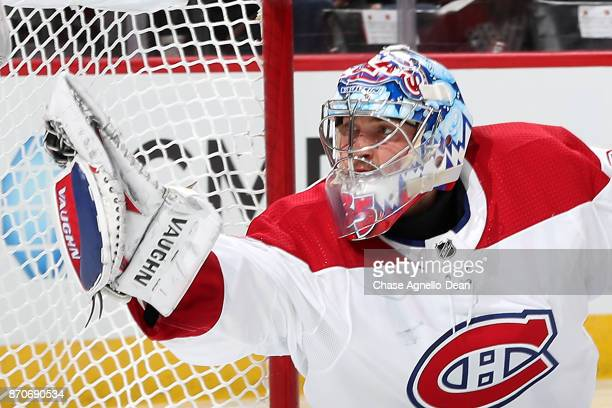 Goalie Charlie Lindgren of the Montreal Canadiens catches the puck in the second period against the Chicago Blackhawks at the United Center on...