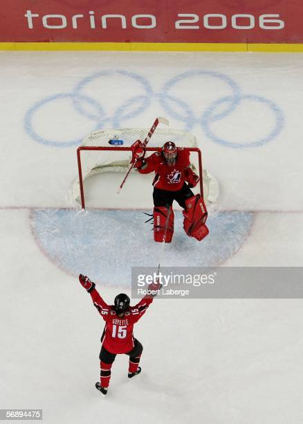 Goalie Charline Labonte and Danielle Goyette both of Canada celebrate their 4-1 victory over Sweden to win the gold medal in women's ice hockey...