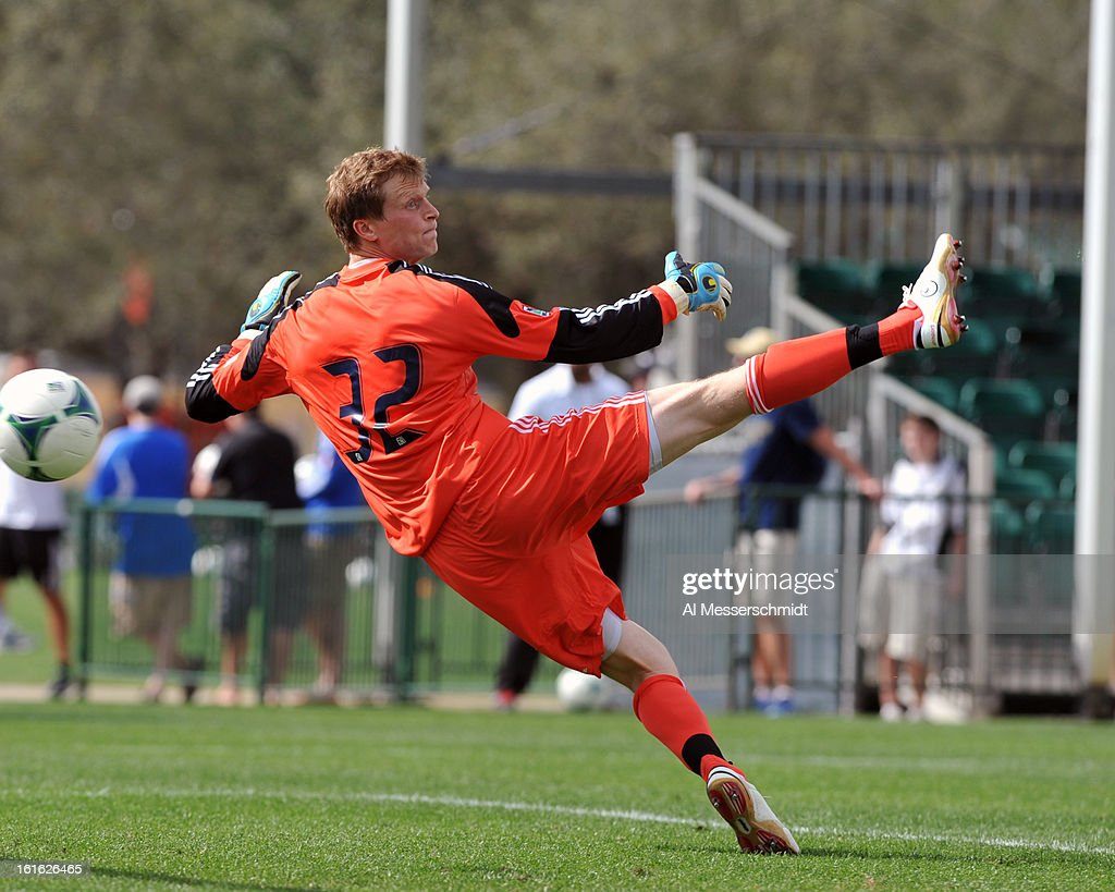 Goalie Chase Harrison #32 of the Philadelphia Union dives for a shot against the Columbus Crew February 13, 2013 in the second round of the Disney Pro Soccer Classic in Orlando, Florida.