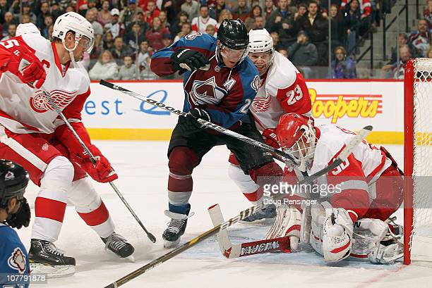 Goalie Chris Osgood of the Detroit Red Wings collected the puck as Brad Stuart defends against Paul Stastny of the Colorado Avalanche at the Pepsi...