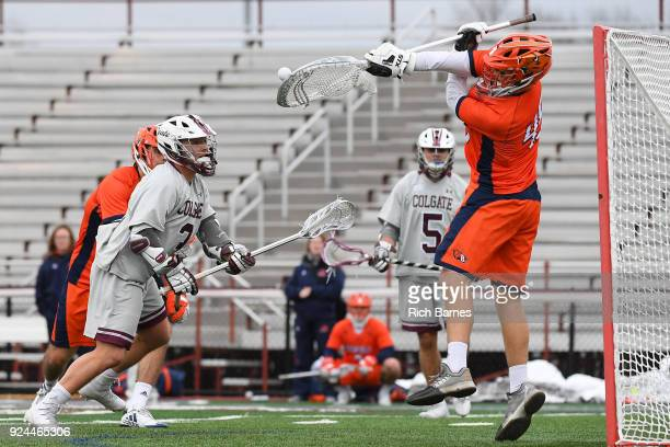 Goalie Christian Klipstein of the Bucknell Bison makes a save on a shot by James Caddigan Jr #3 of the Colgate Raiders during the first half at Andy...