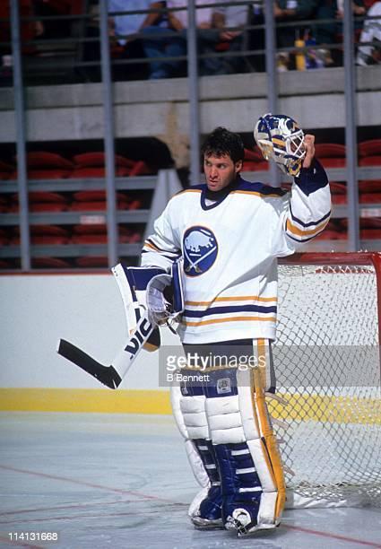 Goalie Clint Malarchuk of the Buffalo Sabres takes a break during an NHL game circa 1991 at the Buffalo Memorial Auditorium in Buffalo New York