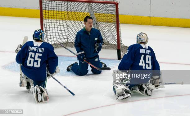 Goalie coach Ian Clark of the Vancouver Canucks works with goalies Michael Dipietro and Braden Holtby on the first day of the Vancouver Canucks NHL...