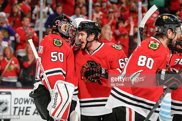 Goalie Corey Crawford and Andrew Shaw of the Chicago Blackhawks celebrate after defeating the Anaheim Ducks 5-2 in Game Six of the Western Conference...