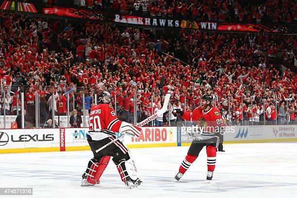 Goalie Corey Crawford and Brandon Saad of the Chicago Blackhawks celebrate after defeating the Anaheim Ducks 54 in Game Four of the Western...