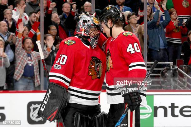 Goalie Corey Crawford and John Hayden of the Chicago Blackhawks celebrate after defeating the New York Rangers 63 at the United Center on November 15...