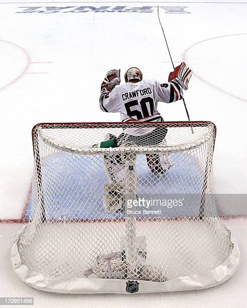 Goalie Corey Crawford of the Chicago Blackhawks celebrates after Brent Seabrook scored the gamewinning goal in overtime to give the Blackhawks a 65...