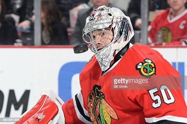 Goalie Corey Crawford of the Chicago Blackhawks eyes the puck during the NHL game against the Carolina Hurricanes on March 02 2015 at the United...