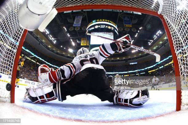 Goalie Corey Crawford of the Chicago Blackhawks gives up a first period goal to Chris Kelly of the Boston Bruins in Game Six of the 2013 NHL Stanley...